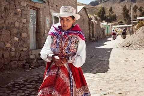 Hat, Tourism, Sun hat, Headgear, Fashion accessory, Street fashion, Maroon, Tradition, Fedora, Cobblestone,