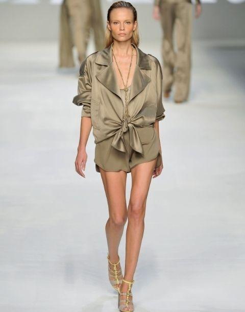 Brown, Skin, Fashion show, Sleeve, Shoulder, Joint, Outerwear, Human leg, Runway, Fashion model,