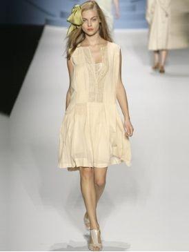 Clothing, Leg, Brown, Sleeve, Human leg, Shoulder, Dress, Textile, Joint, Formal wear,