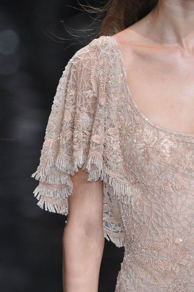 Clothing, Shoulder, Textile, Joint, Fashion, Neck, Embellishment, Lace, Fur, See-through clothing,