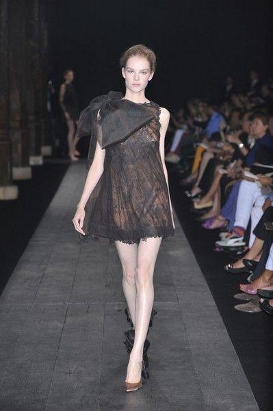 Clothing, Footwear, Fashion show, Shoulder, Runway, Dress, Joint, Human leg, Outerwear, Fashion model,