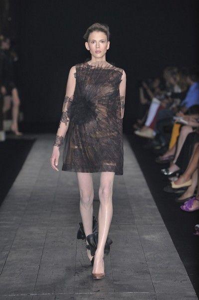 Footwear, Fashion show, Dress, Human leg, Joint, Runway, Style, Fashion model, One-piece garment, Fashion,