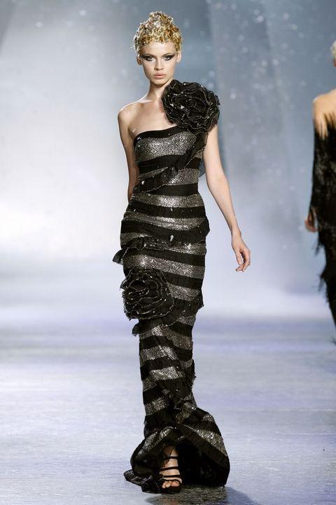 Clothing, Human, Leg, Human body, Fashion show, Shoulder, Joint, Fashion model, Dress, Waist,