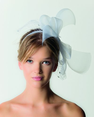 Lip, Hairstyle, Eyebrow, Style, Eyelash, Hair accessory, Headpiece, Headgear, Costume accessory, Art,