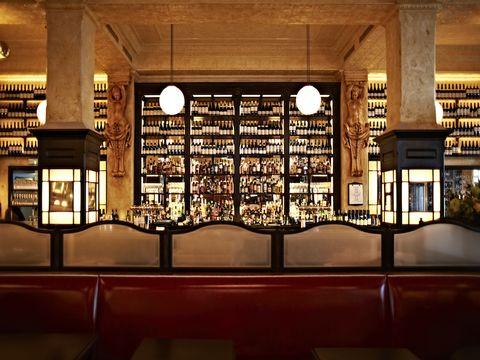 Glass, Ceiling, Interior design, Light fixture, Symmetry, Beam, Column,