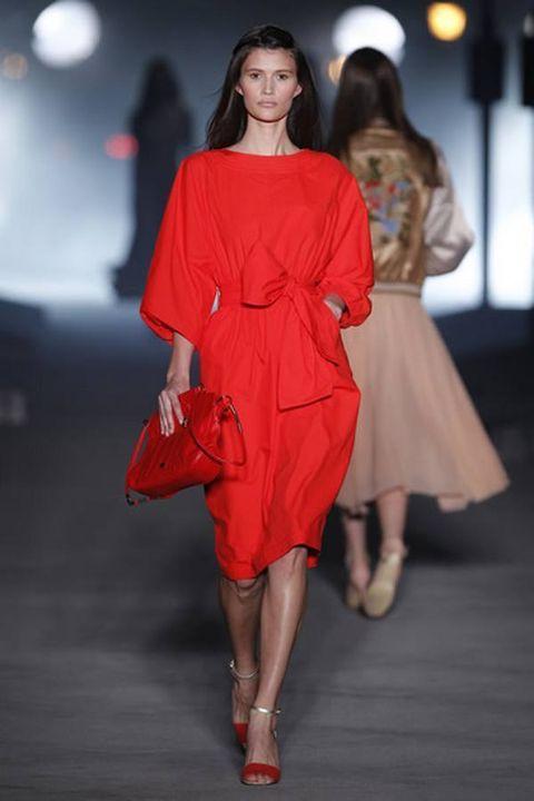 Leg, Human leg, Fashion show, Shoulder, Joint, Red, Dress, Runway, Fashion model, Style,