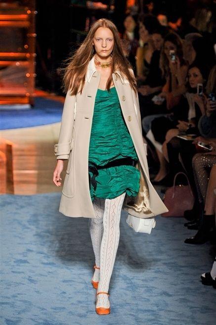 Footwear, Head, Fashion show, Shoulder, Runway, Joint, Outerwear, Fashion model, Style, Jacket,