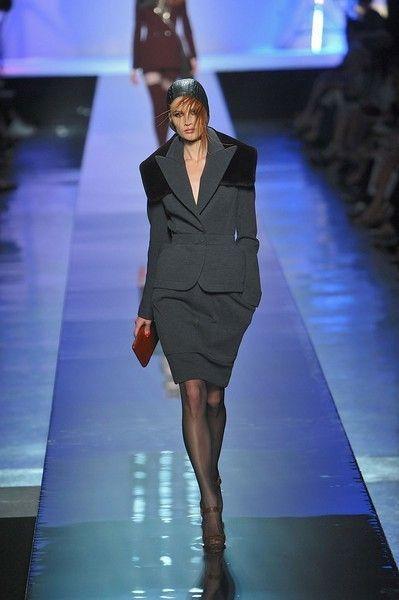 Fashion show, Event, Human body, Shoulder, Human leg, Joint, Dress, Outerwear, Runway, Fashion model,