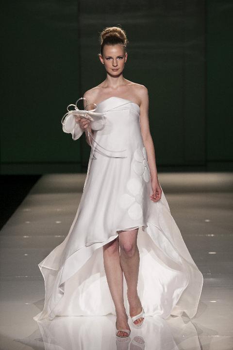 Clothing, Dress, Human body, Shoulder, Fashion show, Shoe, Bridal clothing, Textile, Joint, Fashion model,