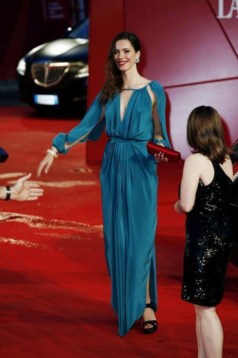 Dress, Shoulder, Flooring, Outerwear, Red, Headlamp, Style, Grille, Formal wear, Automotive lighting,