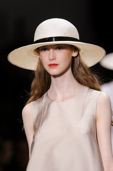 Clothing, Hat, Lip, Hairstyle, Skin, Shoulder, Joint, Style, Sun hat, Headgear,