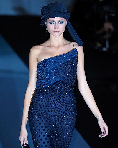 Blue, Dress, Shoulder, Joint, One-piece garment, Electric blue, Hat, Fashion model, Waist, Headgear,