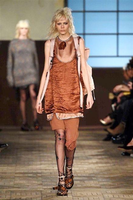 Clothing, Footwear, Leg, Human, Fashion show, Human body, Shoulder, Runway, Human leg, Joint,
