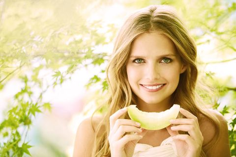 Lip, Mouth, Green, Skin, Happy, People in nature, Facial expression, Summer, Fruit, Sunlight,