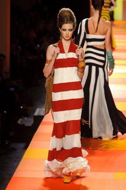 Hairstyle, Dress, Shoulder, Flooring, Fashion show, Style, Fashion model, Formal wear, One-piece garment, Floor,