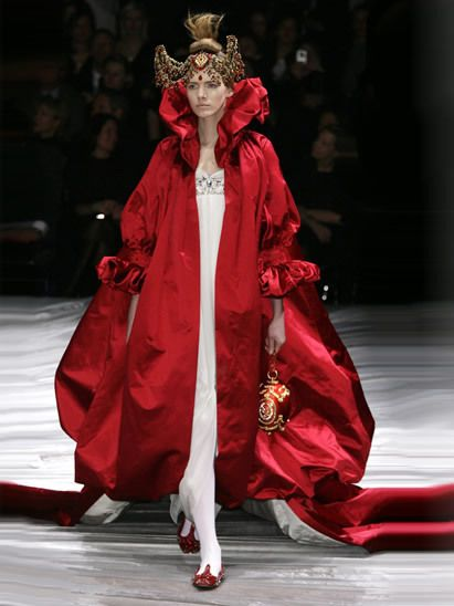 Crown, Shoe, Costume design, Headpiece, Hair accessory, Fashion, Fashion show, Runway, Fashion model, Costume,