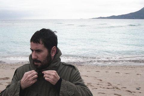 Coastal and oceanic landforms, Facial hair, Mammal, Jacket, Ocean, Beard, Coast, Beach, Shore, Vacation,