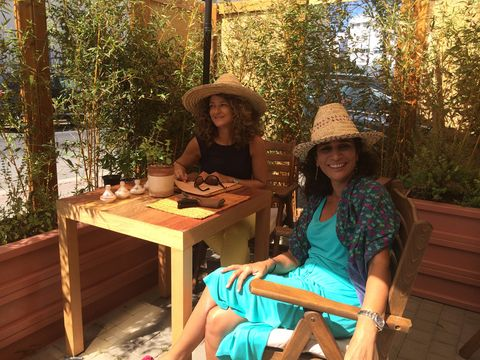 Hat, Sitting, Leisure, Table, Fashion accessory, Outdoor furniture, Outdoor table, Sun hat, Sandal, Lap,