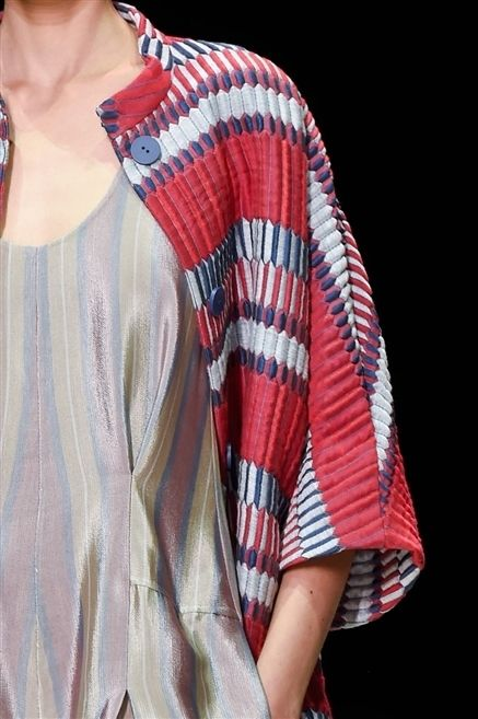 Clothing, Sleeve, Shoulder, Textile, Red, Pattern, Jewellery, Fashion, Carmine, Neck,