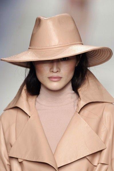 Clothing, Lip, Brown, Hat, Collar, Sleeve, Coat, Khaki, Outerwear, Style,