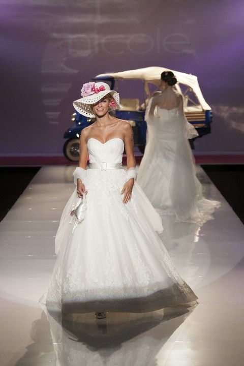 Bridal clothing, Sleeve, Shoulder, Hat, Dress, Gown, Bridal accessory, Wedding dress, Bride, Formal wear,