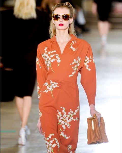 Clothing, Eyewear, Vision care, Shoulder, Sunglasses, Fashion show, Outerwear, Fashion model, Style, Street fashion,