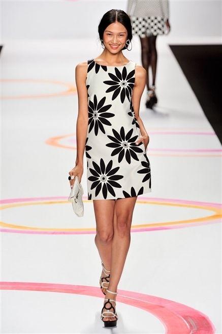 Clothing, Leg, Dress, Human leg, Shoulder, Joint, Fashion show, Fashion model, One-piece garment, Style,