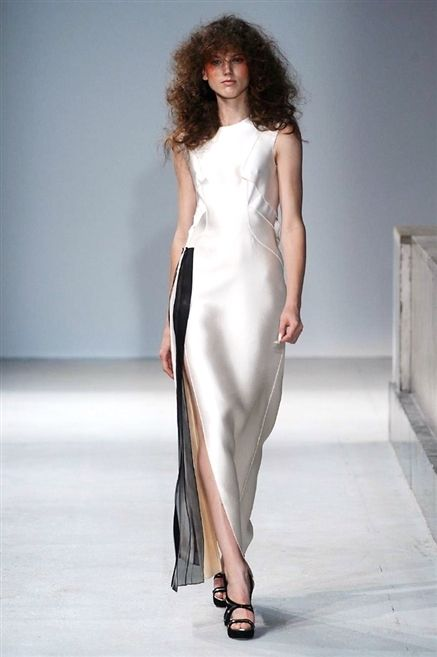 Clothing, Hairstyle, Skin, Dress, Shoulder, Joint, Fashion show, Style, One-piece garment, Fashion model,