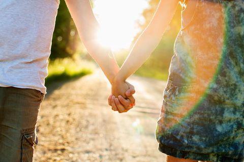 People in nature, Jeans, Interaction, Denim, Sunlight, Orange, Gesture, Love, Holding hands, Khaki,