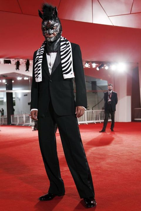 Standing, Flooring, Mask, Style, Suit, Carpet, Formal wear, Costume accessory, Fashion, Blazer,