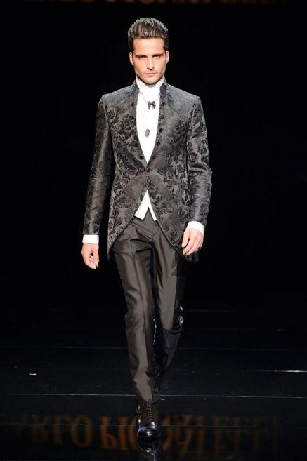 Clothing, Coat, Collar, Trousers, Fashion show, Shirt, Dress shirt, Outerwear, Formal wear, Style,