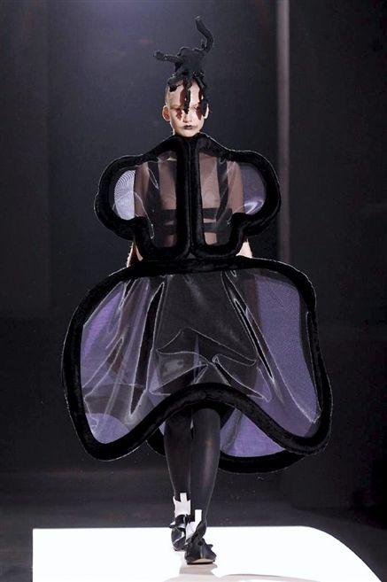 Fashion, Costume accessory, Purple, Costume design, Costume, Sculpture, Fashion design, Headpiece, Gown, Haute couture,