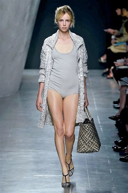 Clothing, Footwear, Leg, Fashion show, Shoulder, Human leg, Runway, Joint, Outerwear, Style,