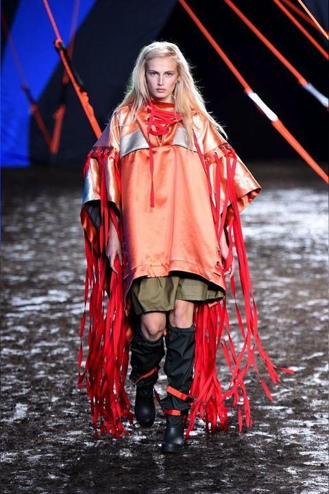 Winter, Red, Boot, Costume design, Fashion, Costume accessory, Costume, Acting, Drama, Fashion model,