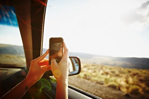 Finger, Glass, Sunlight, Travel, Automotive mirror, Mobile phone, Nail, Road trip, Communication Device, Portable communications device,