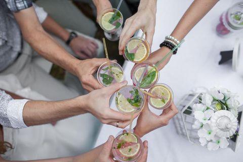 Hand, Table, Petal, Drink, Wrist, Bouquet, Cut flowers, Artificial flower, Recipe, Distilled beverage,