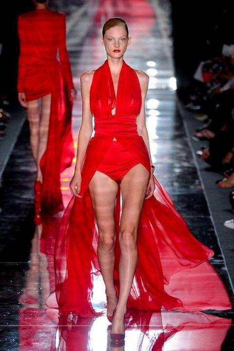 Fashion show, Runway, Human leg, Red, Fashion model, Fashion, Thigh, Model, High heels, Waist,