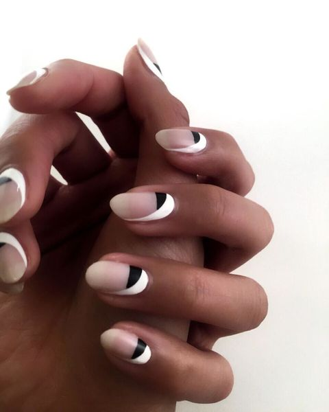 "<p><span class=""redactor-invisible-space"" data-verified=""redactor"" data-redactor-tag=""span"" data-redactor-class=""redactor-invisible-space"">Here's another one for negative nail-enthusiasts. Try this monochrome look by painting your half moons black, then add a swooping splash of white to one side of the nail.</span></p><p><em data-redactor-tag=""em"" data-verified=""redactor"">Design by </em><a href=""https://www.instagram.com/p/BDlaONurUjD/"" target=""_blank""><em data-redactor-tag=""em"" data-verified=""redactor"">@ladyfancynails</em></a></p>"