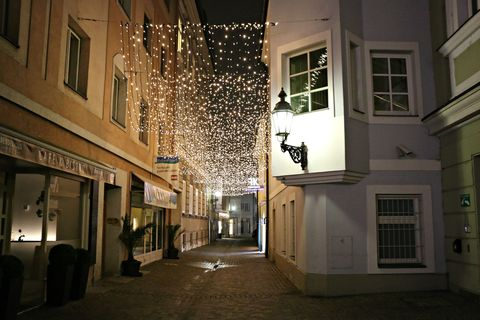 Lighting, Architecture, Facade, Street, Fixture, Alley, Light fixture, Christmas lights, Cobblestone, Midnight,