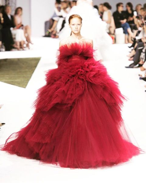 Clothing, Hairstyle, Shoulder, Textile, Dress, Red, Fashion show, Pink, Gown, Fashion model,