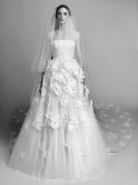 Clothing, Dress, Bridal clothing, Sleeve, Shoulder, Textile, Photograph, Joint, White, Standing,