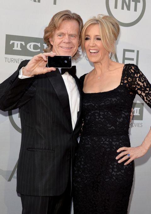 HOLLYWOOD, CA - JUNE 05:  Actors William H. Macy (L) and Felicity Huffman take a selfie photo at the 2014 AFI Life Achievement Award: A Tribute to Jane Fonda at the Dolby Theatre on June 5, 2014 in Hollywood, California. Tribute show airing Saturday, June 14, 2014 at 9pm ET/PT on TNT.  (Photo by Lester Cohen/WireImage)