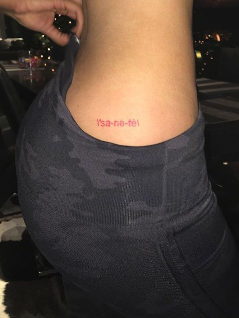 """<p>The super famous 18-year-old showed off her newest ink from <a href=""""http://www.marieclaire.com/celebrity/g3317/celebrity-tattoos/"""" target=""""_blank"""">celebrity artist Bang Bang</a> <a href=""""https://www.instagram.com/p/_05b1TnGm2/?taken-by=kyliejenner"""" target=""""_blank"""">on Instagram</a>: the phonetic spelling of """"sanity"""" in red ink on her right hip. The tattoo matches her other red ink—a heart above her elbow, also by Bang Bang. She also has an unidentified tat on her left hip...perhaps, """"insanity?"""" The jury is out.</p>"""