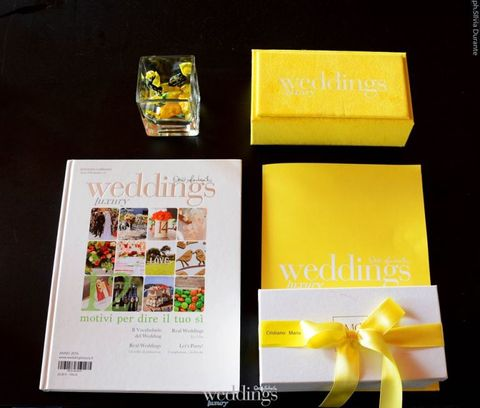 Yellow, Text, Petal, Ribbon, Paper product, Material property, Paper, Label, Graphic design,
