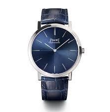 Product, Blue, Watch, Analog watch, Glass, Photograph, White, Watch accessory, Fashion accessory, Font,