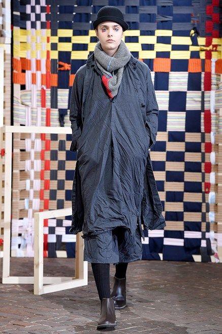 Textile, Outerwear, Winter, Jacket, Street fashion, Pattern, Boot, Scarf, Fur, Fashion model,