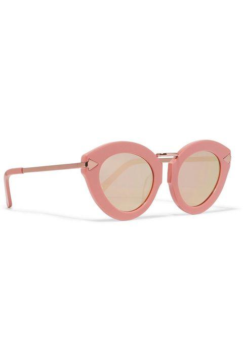 """<p><a href=""""https://www.net-a-porter.com/us/en/product/838453/Karen_Walker/lunar-flowerpatch-cat-eye-acetate-and-rose-gold-tone-mirrored-sunglasses"""" target=""""_blank"""">Net-A-Porter</a></p>"""