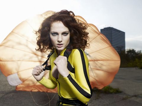 Yellow, Cool, Beauty, Photo shoot, Photography, Outerwear, Hand, Smile, Long hair, Jacket,