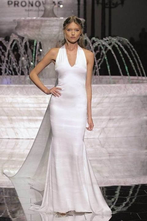 Gown, Fashion model, Clothing, Wedding dress, Dress, Bridal party dress, Bridal clothing, Shoulder, Fashion, Haute couture,