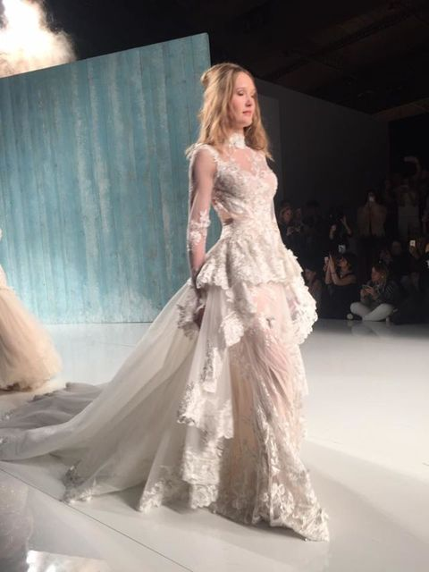 Clothing, Hairstyle, Dress, Human body, Shoulder, Textile, Fashion show, Gown, Formal wear, Style,